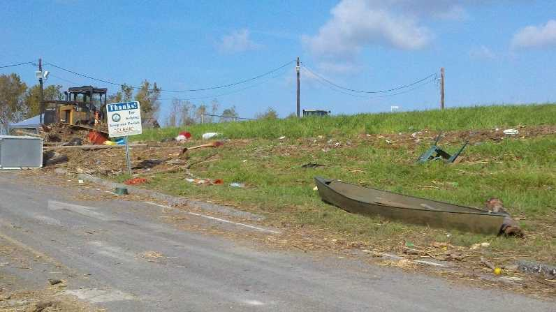 Debris is strewn beside a roadway in the Braithwaite community on the eastbank of Plaquemines Parish.