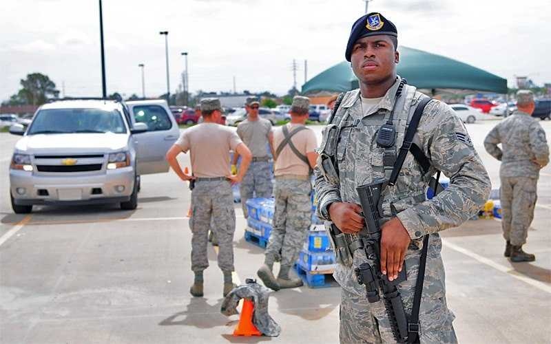 CHALMETTE, La. – Senior Airman Santiago Mabens, of the Louisiana Air National Guard's 159th Security Forces Squadron, remains vigilant while maintaining security while local residents pass through a commodities distribution site in the aftermath of Hurricane Isaac in Chalmette, La., Aug. 31, 2012. These distributions sites were set up across the state to assist those in need and have various items available including water, ice and MREs.