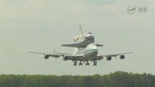 The space shuttle was scheduled to fly over the Stennis Space Center in Mississippi and NASA's Michoud Assembly Facility in New Orleans East on Monday morning but now the flight is scheduled for Tuesday due to weather.