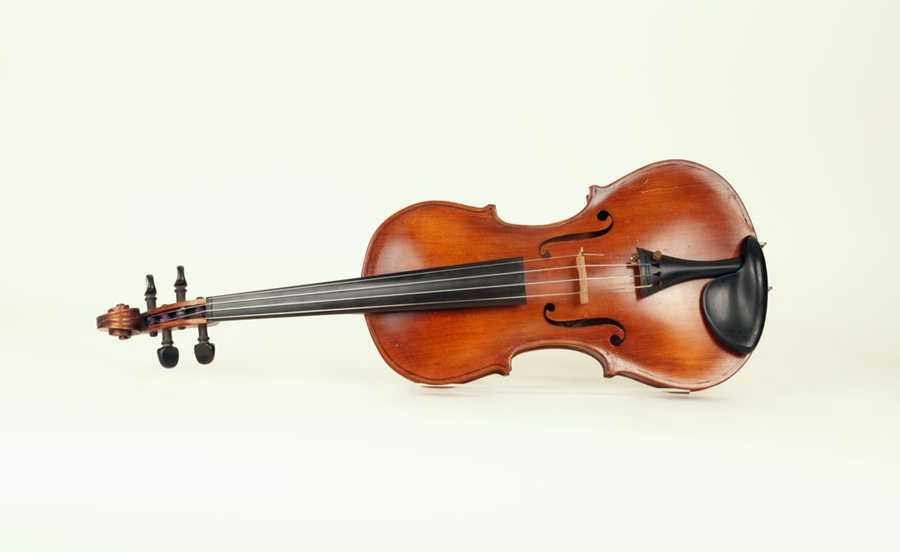 Violin carved by Clair Cline in Stalag Luft I.