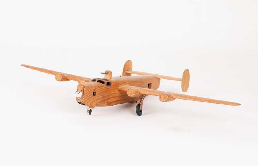 B-24 model carved by Clair Cline in Stalag Luft I.