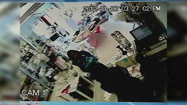 Police say two women were caught on camera stealing the wallet of a bridal shop owner.