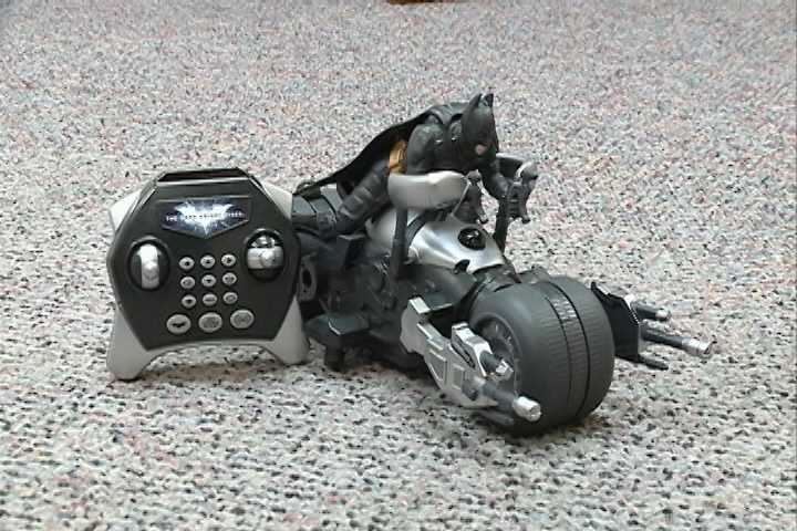 Batman the Dark Knight Rises U-Command Bat Pod has flashing tires, and special sound effects, it zips and turns with the control of a remote. Click here for more.
