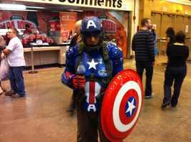 A fan stays hydrated as he wears his gear in celebration of Captain America.