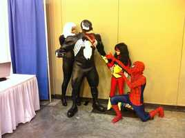 A family bonds as collected themed costumes of characters from the comic book The Amazing Spider-Man.