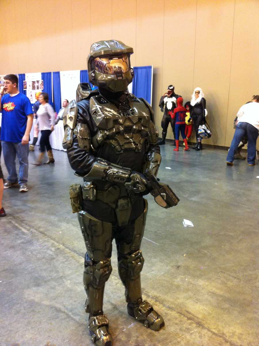 A fan poses as Master Chief from the Halo video game franchise.