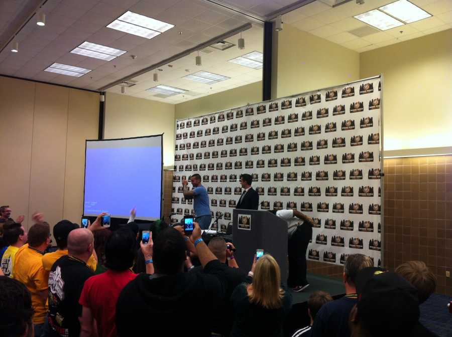 WDSU sports anchor Fletcher Mackel emcees a panel at Wizard World Comic Con for pro wrestler CM Punk.