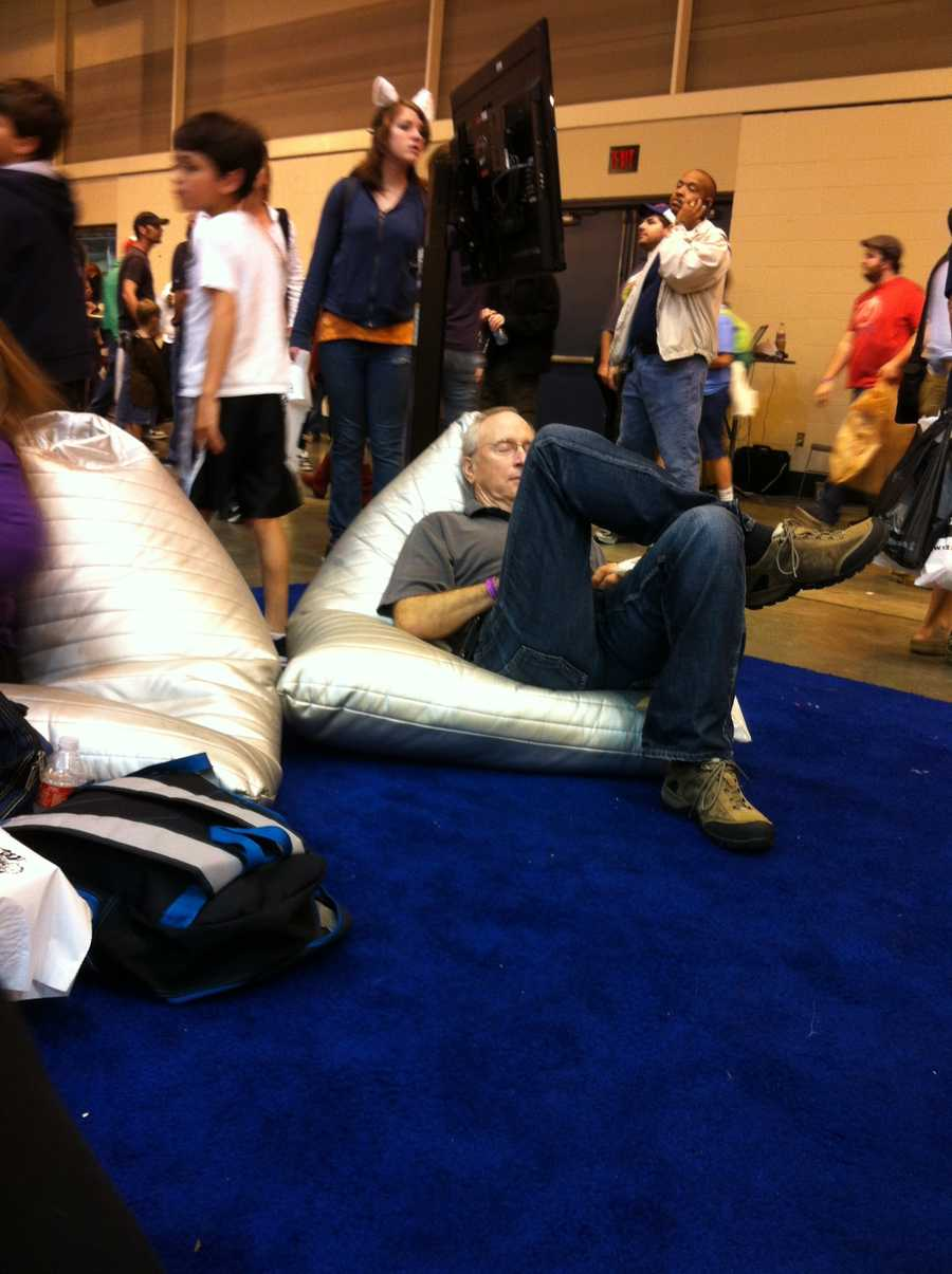 This Comic Con goer had to recharge his super powers with a nap.