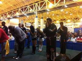 Best known for his work as the Green and White Ranger from the Power Ranger series, actor, and now MMA fighter, Jason David Frank shows Comic Con goers a few martial art moves.