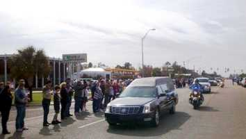 The journey included a stretch of travel along Front Street, where residents paid their respects.