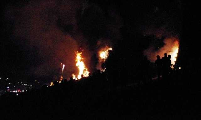 Right on time -- at 7 p.m. -- the fires were set and the levees began to glow.