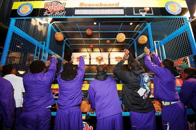 Tiger football players try their hand at another sport during the Chick-fil-A Bowl welcome party.