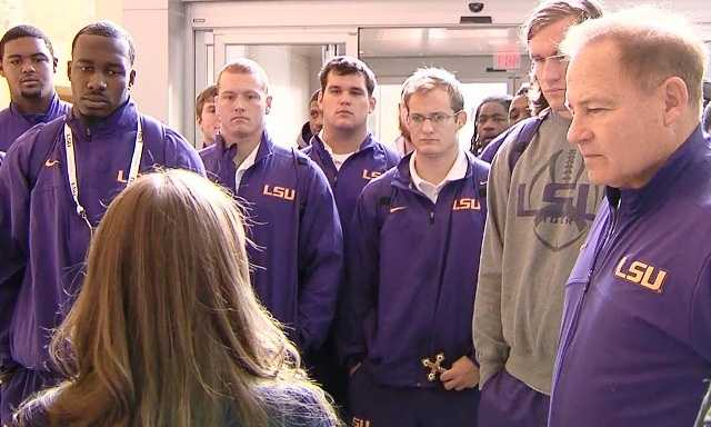 A visit with children who spent Christmas in the hospital is a tradition for teams participating in many college bowl games, including the Chick-fil-A Bowl.