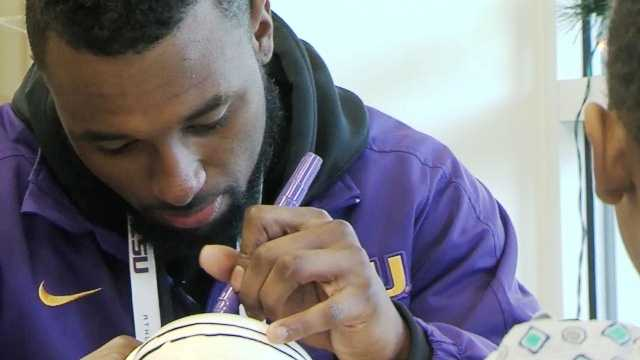 Players decorated and distributed miniature football helmets during their visit with young patients at Scottish Rite Hospital.