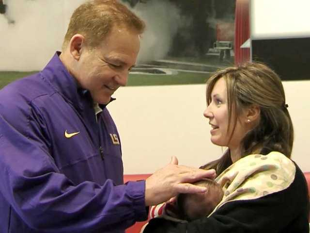 Coach Miles meets one of the youngest patients at Scottish Rite Hospital.