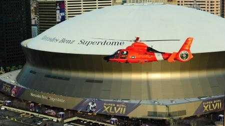 A Dolphin helicopter out of Coast Guard Station New Orleans patrols the city in the days before Super Bowl XLVII. The Coast Guard is one of 16 agencies working security for the event.