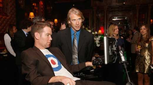 "Steve Gleason and producer/director Michael Bay attend the ""Big Game, Big Give"" event in New Orleans."