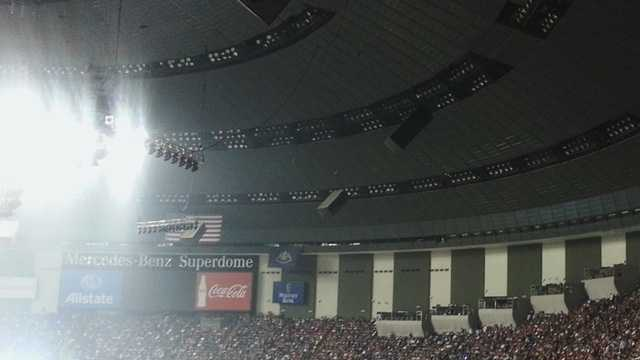 Half of the Mercedes-Benz Superdome is plunged into darkness about 7:35 p.m. -- in the middle of Super Bowl XLVII.