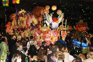 """While taking a breath from shouting """"throw me something, mister!"""" you've probably wondered how the spectacular floats parading down the street are made. Well, it all happens behind the scenes at Mardi Gras World, where the artists of Kern Studios bring Mardi Gras to life!"""
