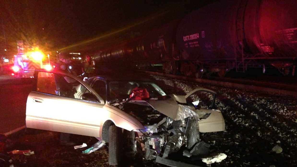 Woman dies after train collides with car