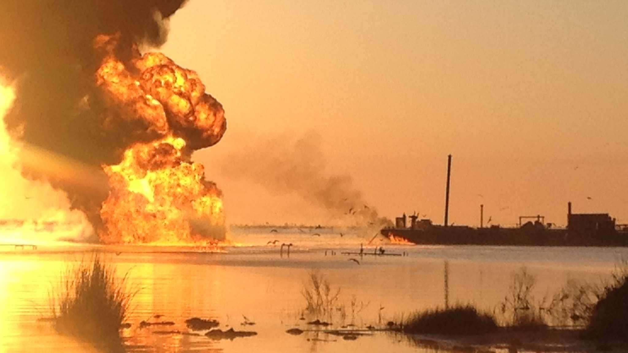 A pipeline burns after a collision involving the tug boat Shanon E. Setton, near Bayou Perot 30 miles south of New Orleans, March 15, 2013.