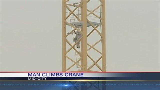 "New Orleans police responded Monday morning to an incident in Mid-City after a person they call a ""possible mental patient"" climbed a crane hundreds of feet in the air."