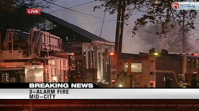 New Orleans firefighters battled a 3-alarm fire in Mid-City Monday morning.