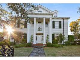 """The listing describes the home as a """"Stately mansion located in the heart of Metairie Club Gardens. Designed by renowned architect, Solis Seiferth. There are magnificent architectural details including decorative pediments, fabulous windowin entrance & beautiful milled bookcase in the living room. This home has beautiful formal rms, lg kitchen, 5 bdrms & 4.5 baths & 3rd floor game room. There is a 4 car garage w/ 2 baths, bedroom, office, gym."""""""