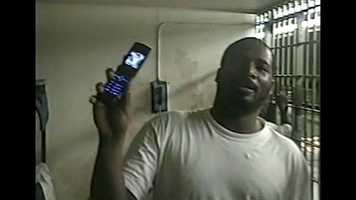 """Inmate holding a cell phone.Sign up nowfor Breaking News email alerts or top Headlineshere. (On mobile website use drop down top right, tap """"Get Email Alerts"""")"""