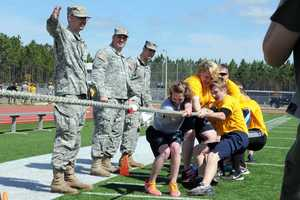 JROTC team competes in a tug of war battle.