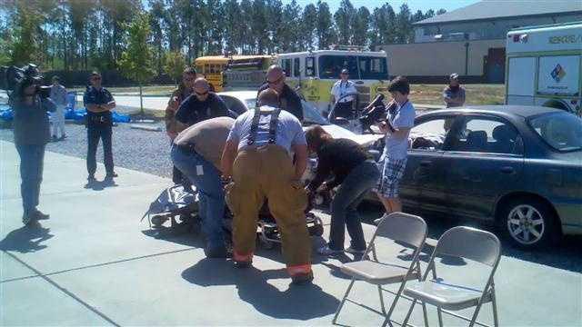 With prom night approaching, rescue workers demonstrate a mock crash to show the dangers of drinking and driving.