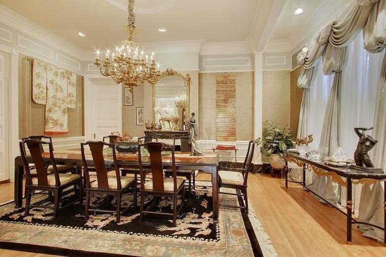 Dining Room: Gorgeous marble mantel, faux marble baseboards, pocket doors & picture molding.