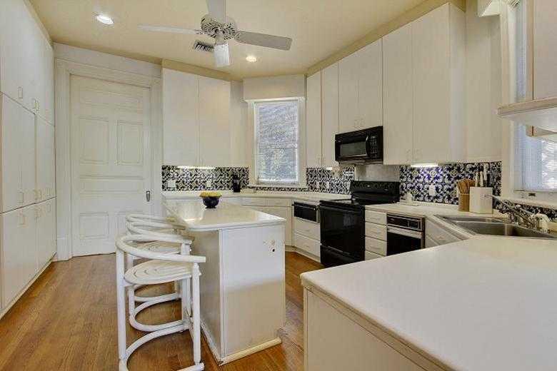 Kitchen: Light-filled & bright, cobalt blue backsplash & double sinks.
