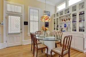 Breakfast Room:  Beautiful built-in glass front cabinets & wood floors.