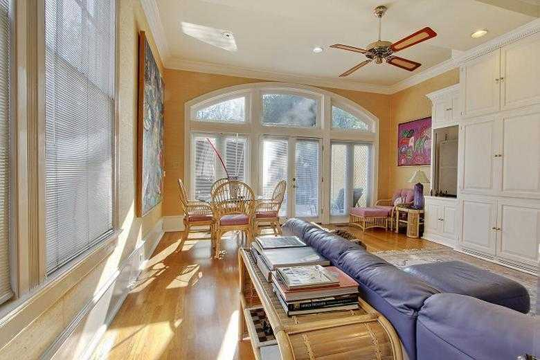 Den/Family/Great Room: Downstairs den with built-ins, wood floors & a wall of windows leading to a custom deck & pool.