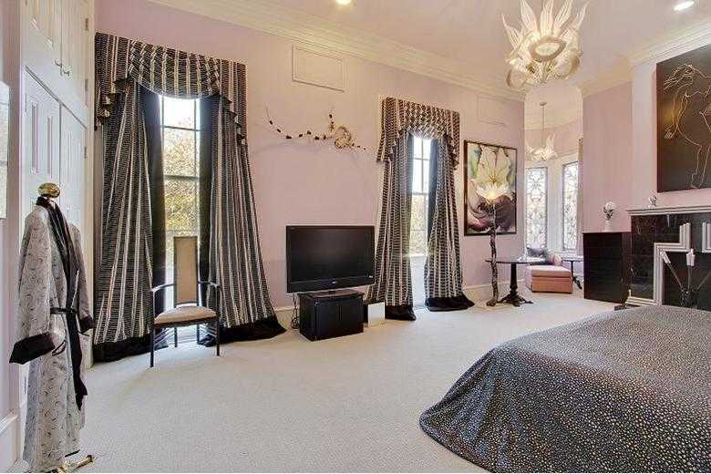 Master Bedroom: Lively, light-filled with 2 closets, large walk-in closet & a full wall of built-in closets.