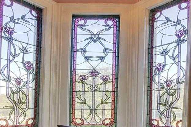 Other: Cozy reading nook inside of turret with custom designed stained glass windows.