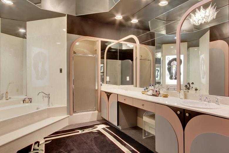 Master Bath/Spa: Custom double vanity & separate Jacuzzi tub & shower.
