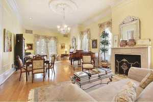 Living Room: Double parlors, two beautiful mantels, wood floors, Waterford chandelier & medallion.