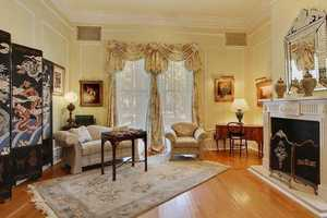 Living Room:  Custom draperies, moldings & windows overlooking St Charles Avenue.