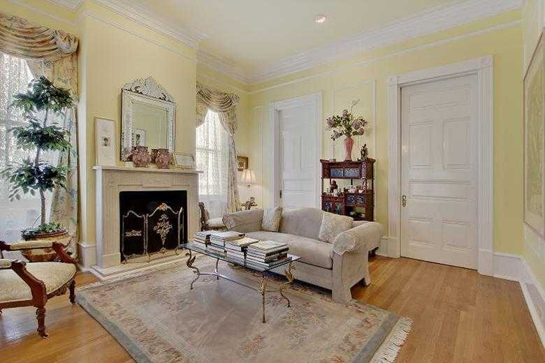 Living Room: Another living room view. Pocket doors, marble mantels, crown & picture molding.