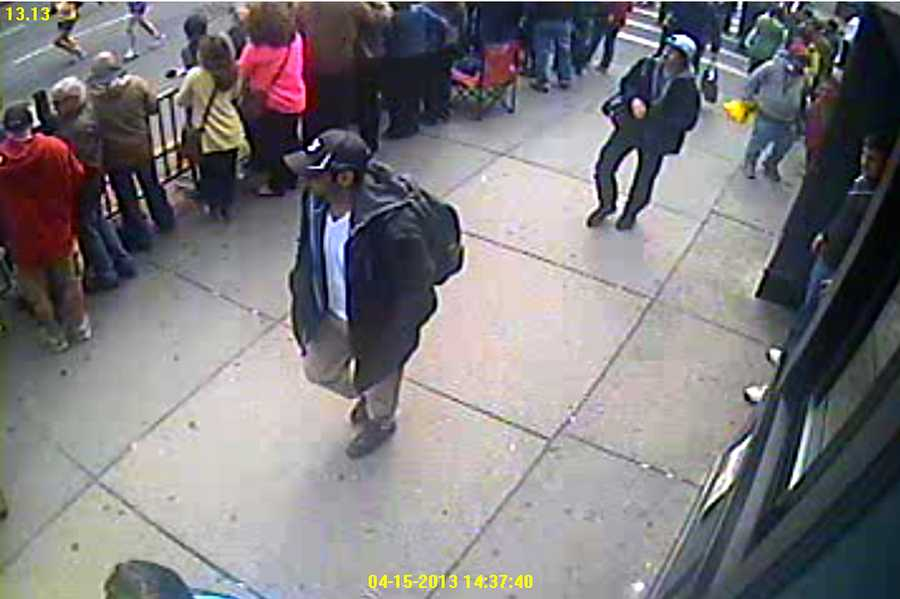 During a news conference on Thursday, the FBI released photos and video and asked for the public's help in identifying two suspects in this week's deadly bombings at the Boston Marathon.