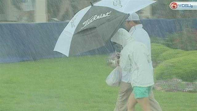 Wednesday's severe weather sends golfers and fans at the Zurich Classic Pro-Am running for cover.