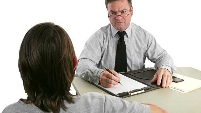 Woman talking to boss, job interview