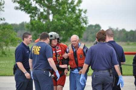 Carl Herman Hagenkotter Jr. is helped by emergency personnel after landing at Coast Guard Air Station New Orleans, Friday. Hagenkotter Jr. and Beverly Parsons were both air-lifted by the Coast Guard after their sailing vessel's mast was broken while sailing 50 miles southwest of Terrebonne Bay.