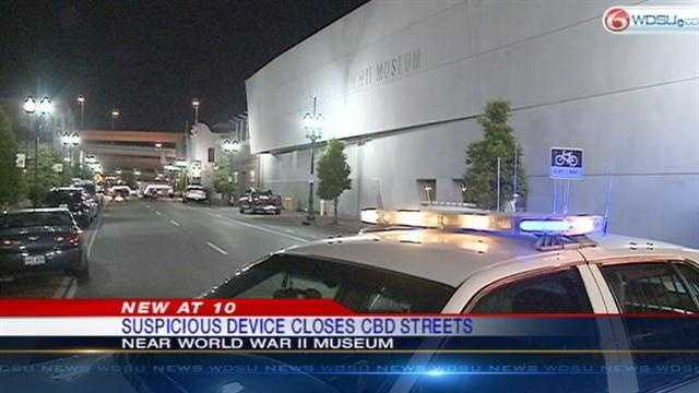 Police investigate a suspicious device found on the side of the National WWII Museum in New Orleans.