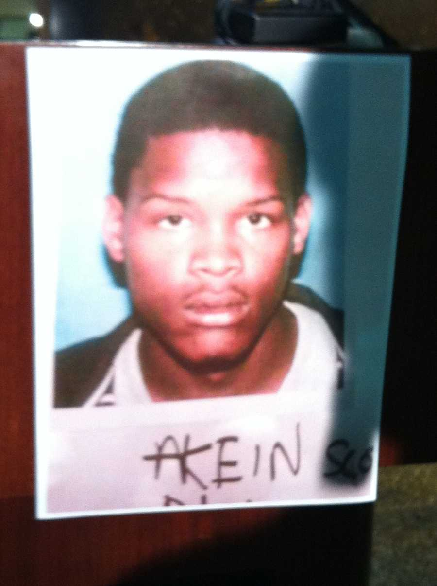 March 13: In an evening news conference, police formally identify Akein Scott as the man sought in the shooting. Read story