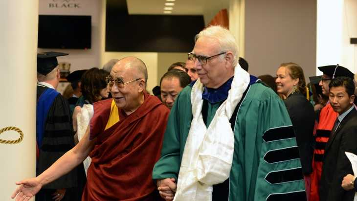 Before he delivered the 2013 commencement address on Saturday (May 18), the Dalai Lama visited backstage with Tulane  administrators, board members and honorees. Here, His Holiness is escorted by Tulane President Scott Cowen. (Photo by Sally Asher).