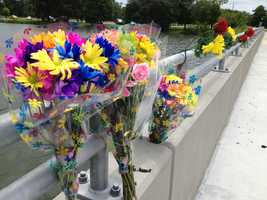 Many brought flowers in remembrance of the once missing school teacher Sunday.