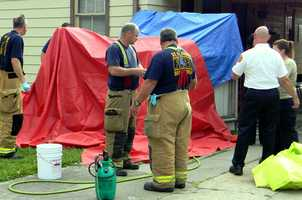 St. Bernard firefighters put up a makeshift tent and provided water to decontaminate children and the suspects involved in the meth lab operation.